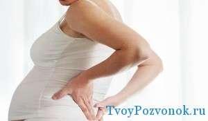 Боль в пояснице у женщины во время беременности